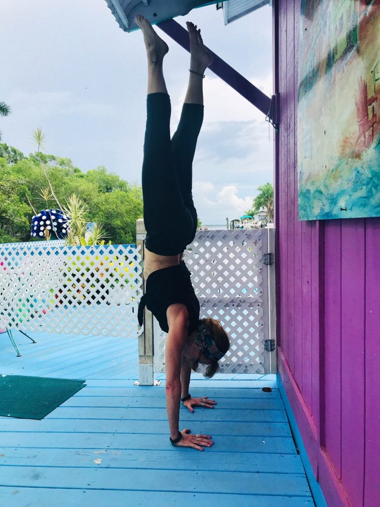 My handstand goal by age 60 is to do a freestanding handstand. I can get myself upside down at nearly 56, but now I want to hold it and play around.