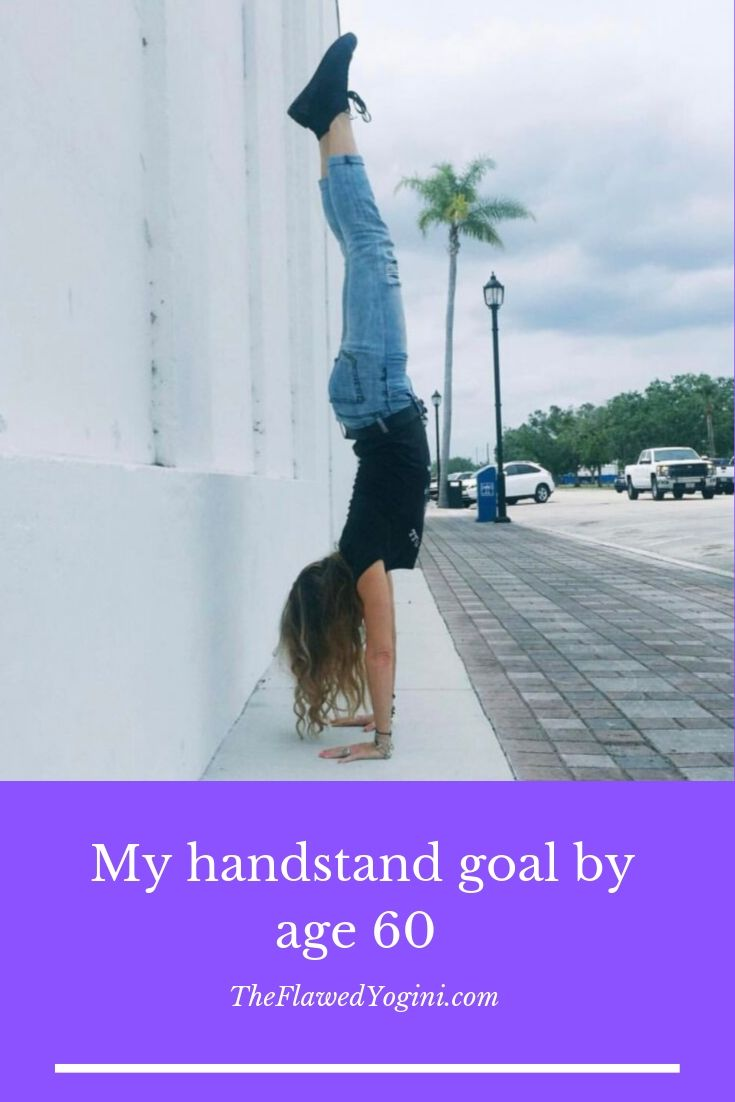 My handstand goal by age 60 is to do a freestanding handstand. I can get myself upside down at nearly 56, but now I want to hold it and play around. #yoga #over50 #senioryoga